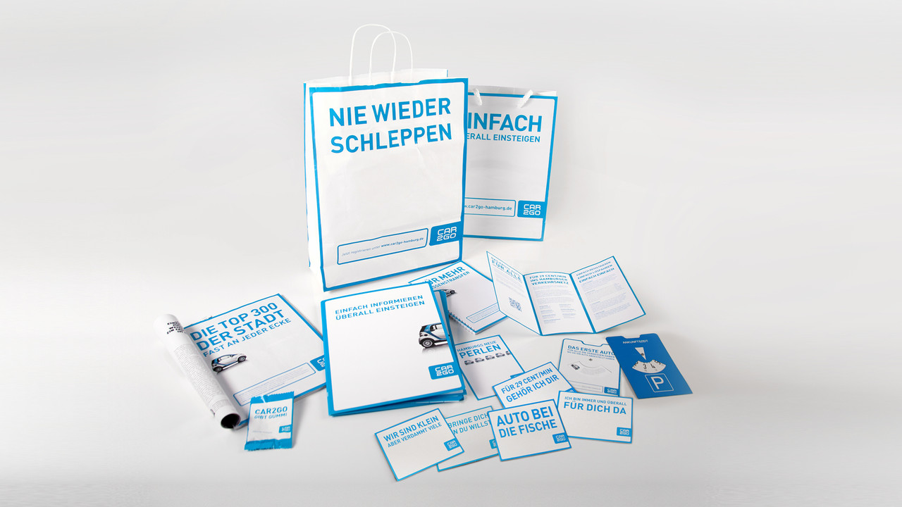 car2go Print Promotionmaterial Flyer, Papiertüte, Visitenkarte. Printanzeige