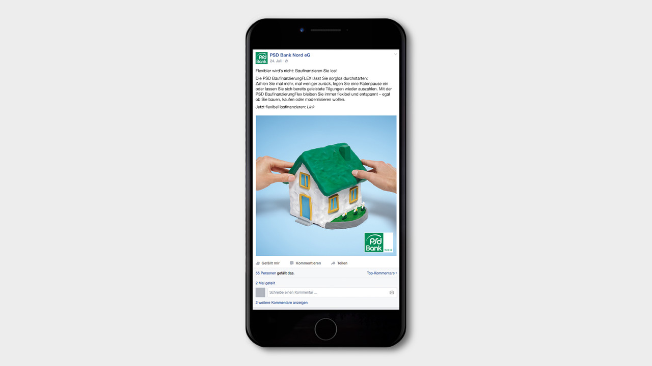 psd Bank Social Posting zwei Händenformen ein Haus aus Knetgummi